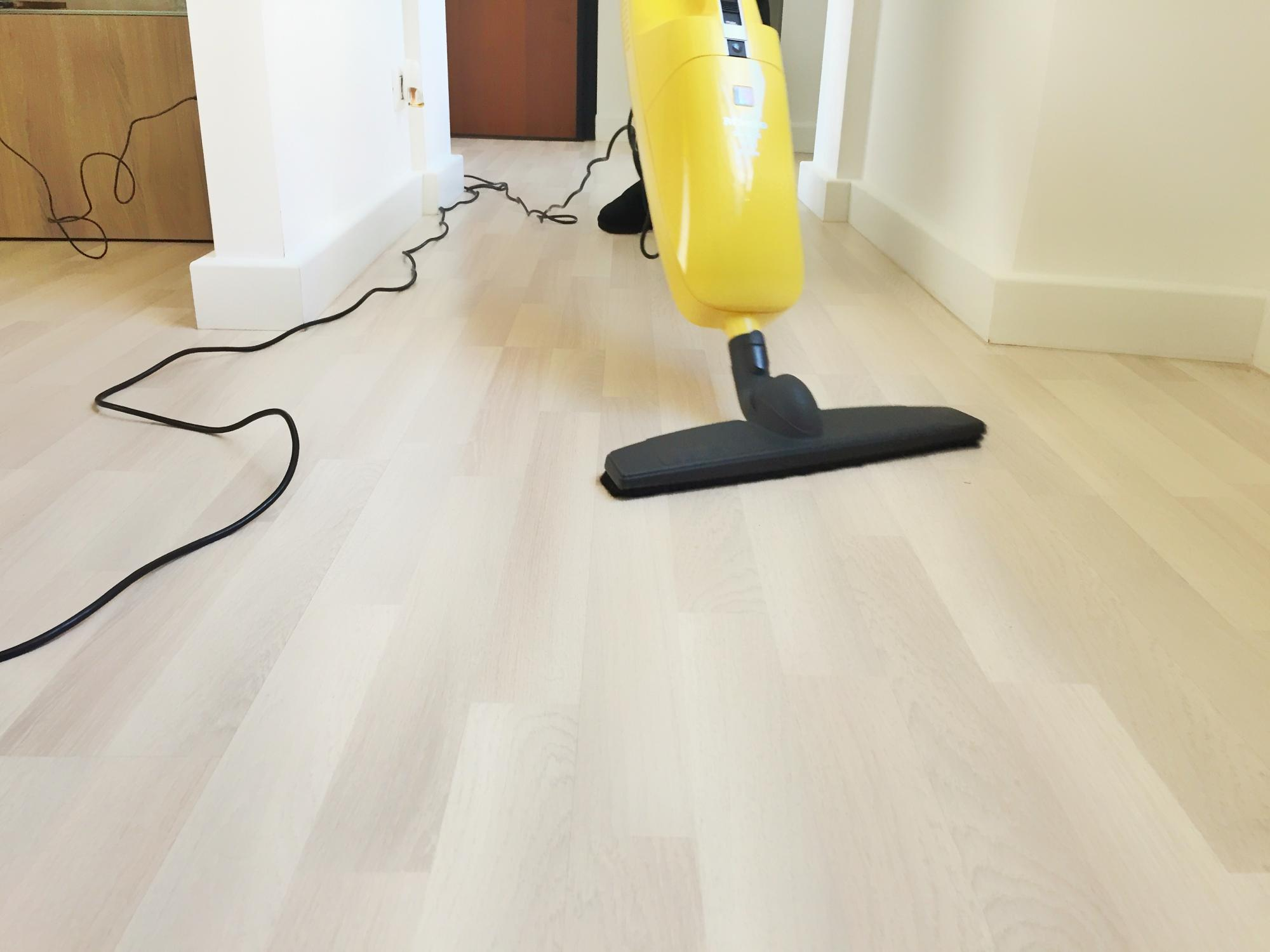 a large vacuum cleaning a wood floor